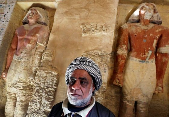 "An Egyptian archaeological worker stands inside the newly-discovered tomb of ""Wahtye"", which dates from the rule of King Neferirkare Kakai, at the Saqqara area near its necropolis, in Giza, Egypt, December 15, 2018."