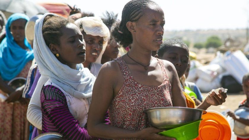 Ethiopians, who fled the conflict in the Tigray region in northern Ethiopia due to the clashes in the operation launched by the Federal Government Forces against the Tigray People's Liberation Front (TPLF), wait to reiceve food in Hamdayit camp after reaching Kassala State, Sudan on December 14, 2020