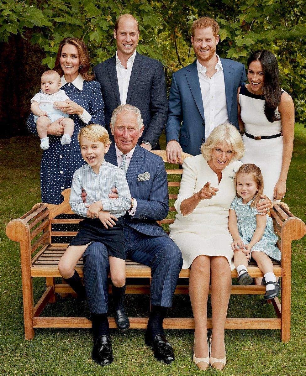 Prince Louis, the Duchess of Cambridge, the Duke of Cambridge, the Duke of Sussex and the Duchess of Sussex. (front row left to right) Prince George, the Prince of Wales, the Duchess of Cornwall and Princess Charlotte, in the gardens of Clarence House
