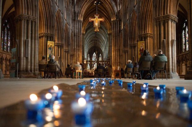 Church goers attend a service in Lichfield Cathedral
