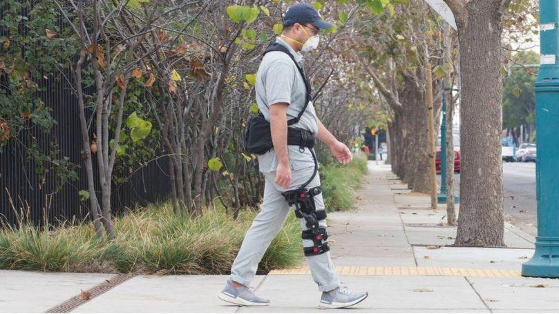 A man wearing a SuitX BoostX knee brace