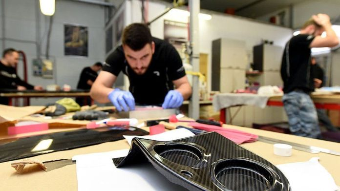 An engineer works on car parts at Mate Rimac's factory on the outskirts of Zagreb