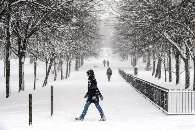 People walk through the snow in Victoria Park in Glasgow on 9 February 2021