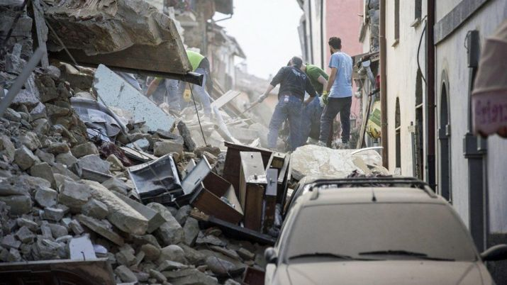 Rescue teams search through collapsed buildings in Amatrice, central Italy, following a 6.2 magnitude earthquake - 24 August 2016