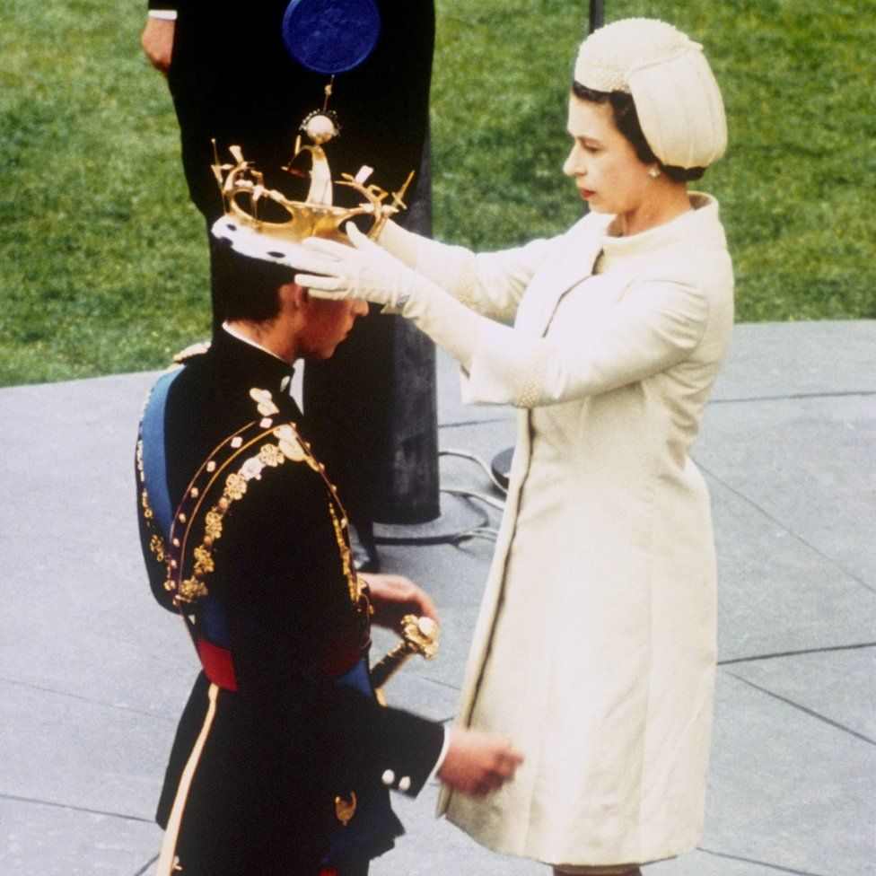 Queen Elizabeth II formally invests her son Prince Charles with the Coronet of the Prince of Wales during a ceremony at Caernarfon Castle in Cardiff