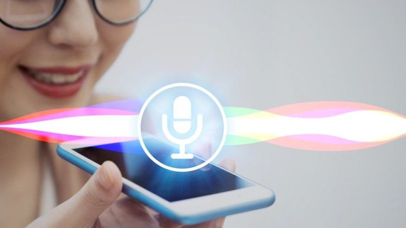 Woman using voice assistant