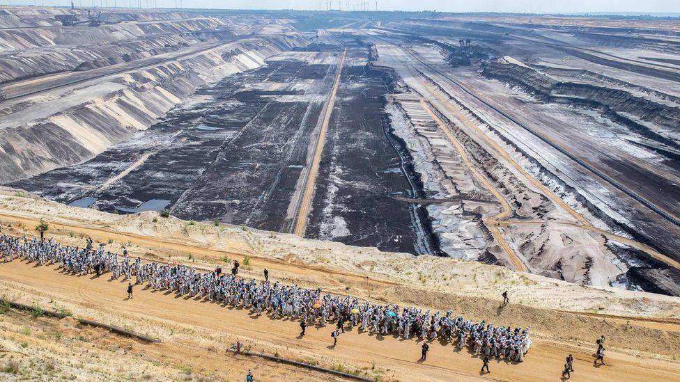 Activists walking through the Garzweiler mine