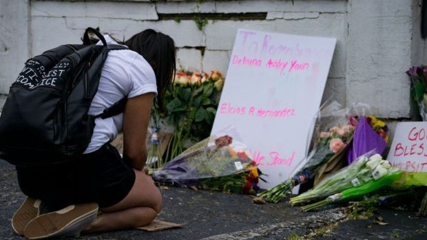 Flowers and signs adorn Gold Spa where activists demonstrated against violence against women and Asians following Tuesday night's shooting where three women were gunned down on March 18, 2021 in Atlanta, Georgia