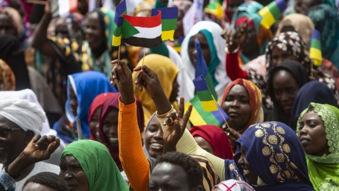 Crowds at a ceremony where Minni Minawi is appointed governor of Darfur, in el-Fasher, Sudan - Wednesday 8 August 2021