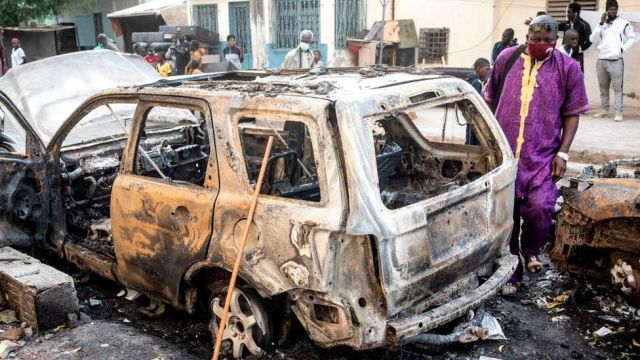 Cars were burnt near the headquarters of a radio station thought to be close to Senegal's government