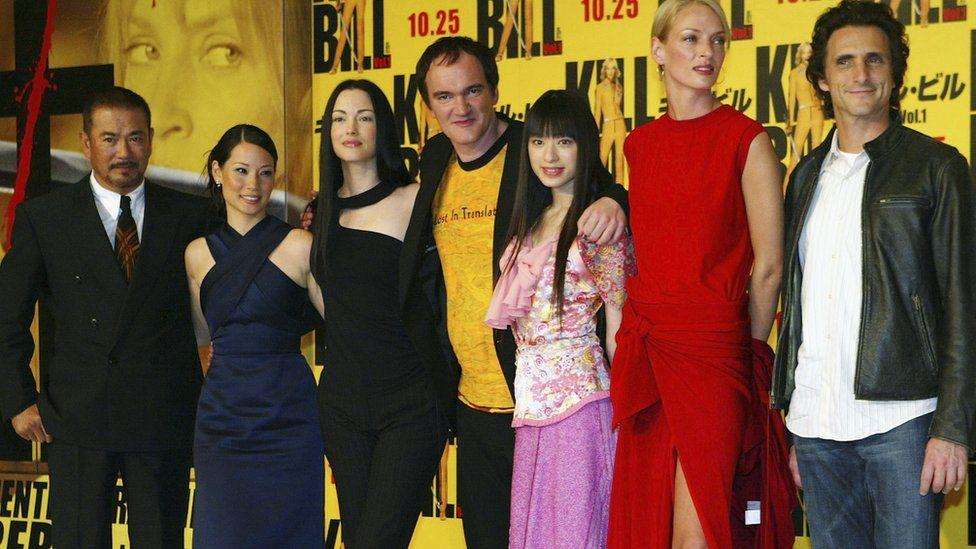 Actors Shinichi Chiba, Lucy Liu, Julie Dreyfus, director Quentin Tarantino, Chiaki Kuriyama, Uma Thurman, and producer Lawrence Bender at the premiere of Kill Bill - Volume One in Tokyo in 2003