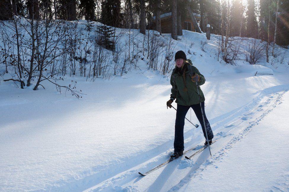Romey walks across the snow