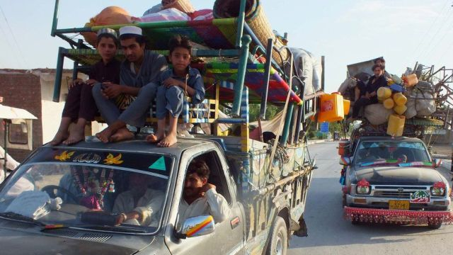 Internally displaced Pakistanis, fleeing from military operations against Taliban militants in North Waziristan, arrive in Bannu, a town on the edge of Pakistan's lawless tribal belt of Waziristan, on June 11, 2014.