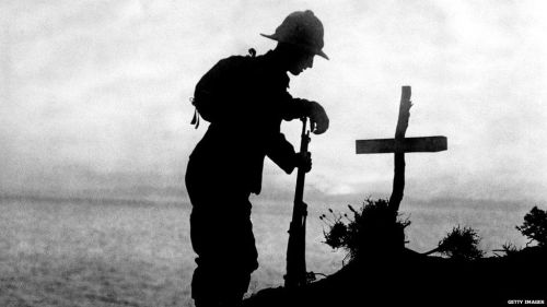 A soldier stands over a grave in Gallipoli in 1915