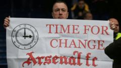Arsenal FC banner time for change