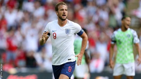 Harry Kane celebrates scoring the second