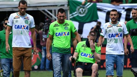 Helio Neto (L), Jackson Follmann (2nd-R) and Alan Ruschel (R), survivors of the LaMia airplane crash in Colombia, arrive at the Arena Conda stadium in Chapeco,
