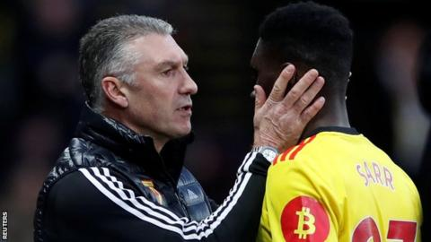 sport Watford manager Nigel Pearson congratulates Ismaila Sarr after the win over Manchester United