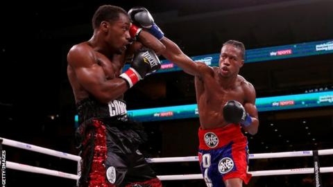 American boxer Patrick Day (right) throws a punch during his fight against Charles Conwell (left)