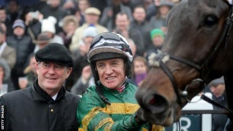 Owner JP McManus, jockey Barry Geraghty and Buveur D'Air after Newbury win