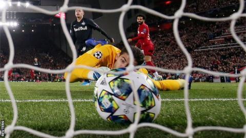 Liverpool's Mohamed Salah scores against Red Bull Salzburg
