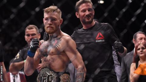 sport Conor McGregor and John Kavanagh after the victory over Jose Aldo in 2015