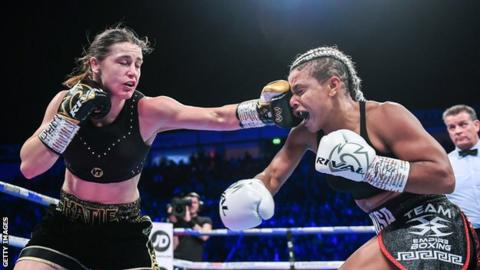 Irish boxer Katie Taylor (left) lands a punch on Christina Linardatou (right) in winning the WBO super-lightweight title