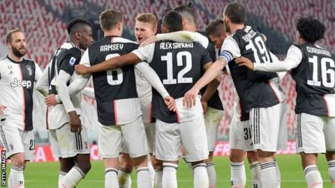 Juventus players celebrate a goal against Inter Milan