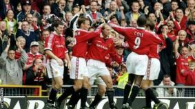 Jordi Cruyff is congratulated by his Manchester United team mates after his 73rd minute equaliser during the FA Carling Premier League game between Manchester United and Wimbledon at Old Trafford in 1999