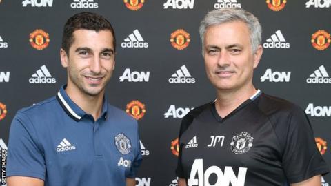 Henrikh Mkhitaryan and Jose Mourinho