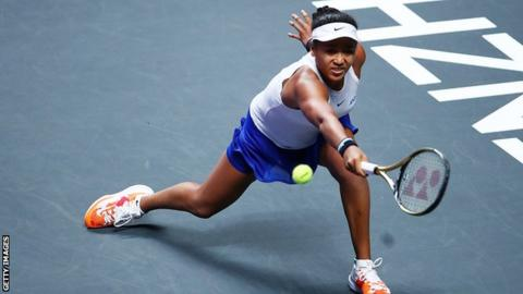 Naomi Osaka reaches for a back hand during her match against Petra Kvitova