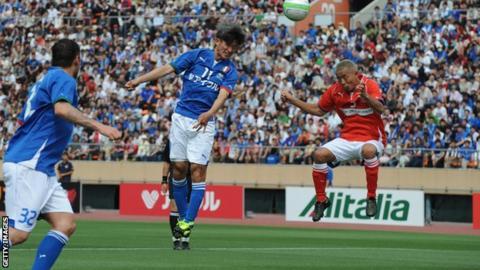 Kazuyoshi Miura (centre) heads the ball