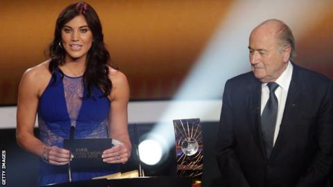 Hope Solo and Sepp Blatter
