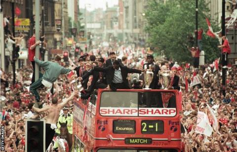 Manchester United celebrate their Treble win of 1999