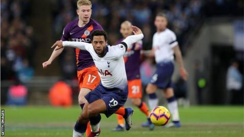 Tottenham midfielder Mousa Dembele goes to play the ball while shielding it away from Manchester City midfielder Kevin de Bruyne