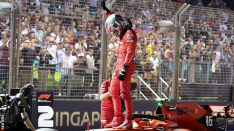 Charles Leclerc celebrates pole in Singapore