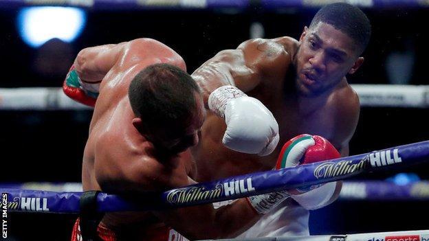 Anthony Joshua punches Kubrat Pulev