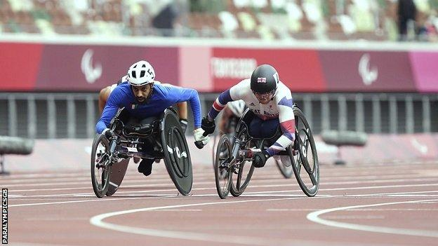 Ahmad Almutairi of Kuwait (left) and GB's Andrew Small (right) racing