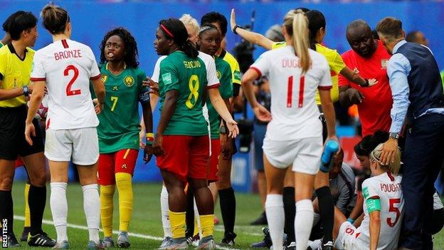 Cameroon captain Gabrielle Onguene (third left) was angry after Steph Houghton was injured by Alexandra Takounda Engolo's late challenge in injury time