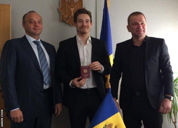 Cook receiving his Moldovan passport