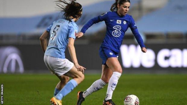 Melanie Leupolz of Chelsea (right) takes on Manchester City's Jill Scott