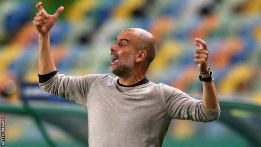 Pep Guardiola reacts on the touchline
