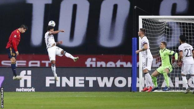 Alvaro Morata heads home Spain's first goal against Germany in the Nations League