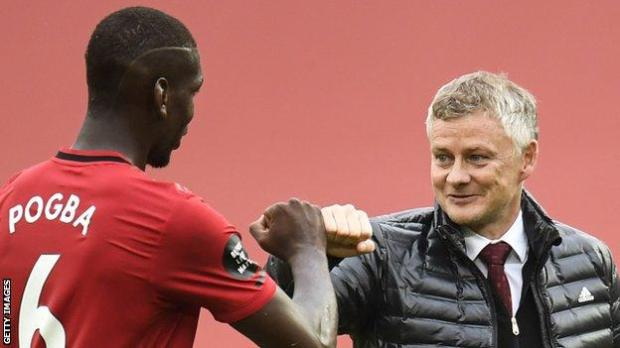 Manchester United midfielder Paul Pogba (left) and manager Ole Gunnar Solskjaer (right) bump fists after a Premier League game