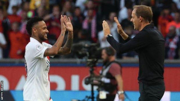 Neymar and Thomas Tuchel embrace