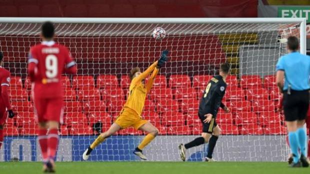 Liverpool goalkeeper Caoimhin Kelleher keeps out a header from Ajax's Klaas-Jan Huntelaar