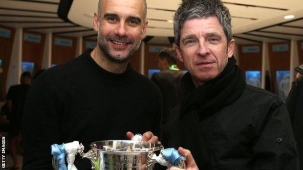Pep Guardiola and Noel Gallagher celebrate City's Carabao Cup win at Wembley in 2020