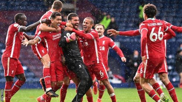 Liverpool celebrate after goalkeeper Alisson scores against West Brom