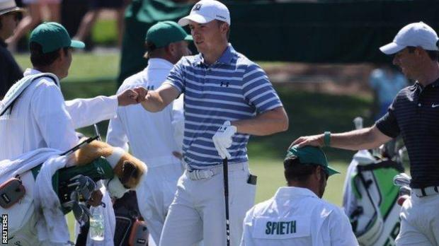 Jordan Spieth and Rory McIlroy with their caddies at Augusta National