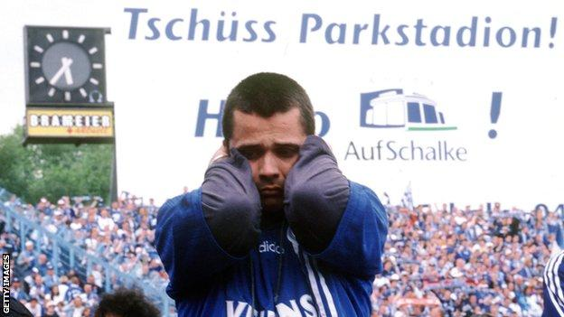 A distraught Schalke fan realises - they have not won the title